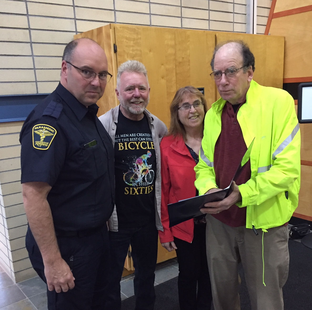 County of Renfrew Emergency Services director Mike Nolan and OVCATA activists Chris Hinsperger, Kathy Eisner, and Ish Theilheimer go over plans for Active Transportation Month.