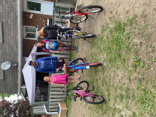 In Pembroke, Tina Panke and family receiving bikes from Bike Bank on May 20.