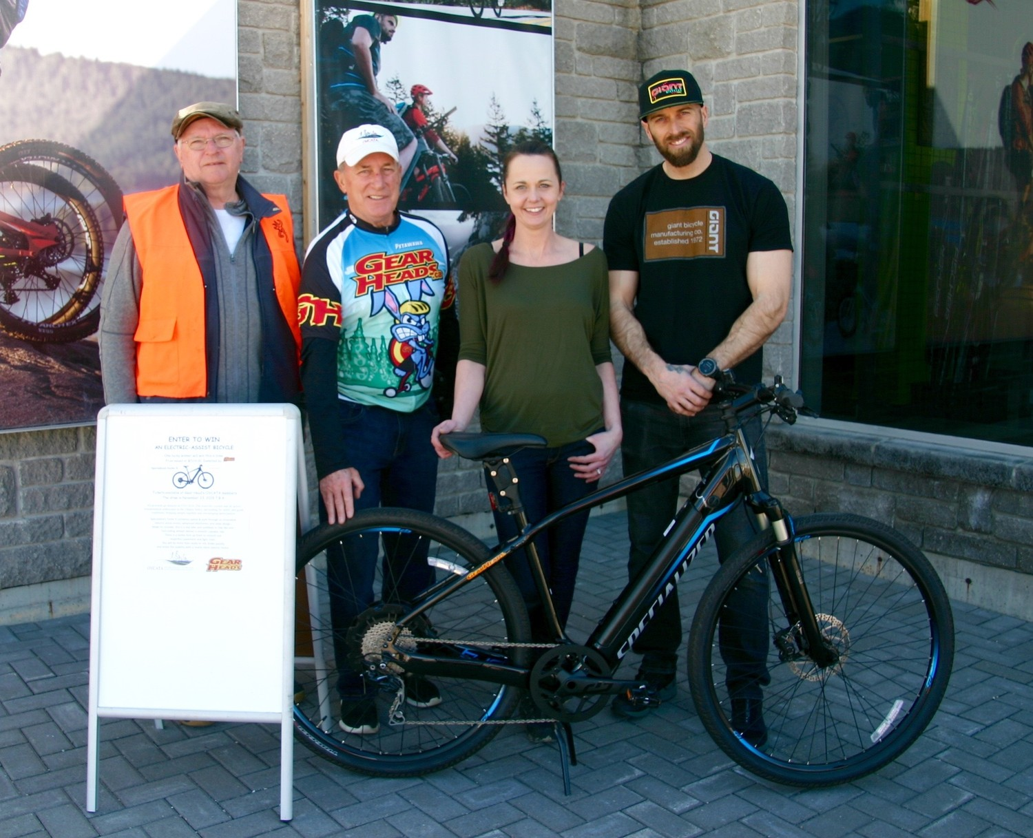 Gearheads gives OVCATA a big boost with donation of a Specialized e-bike for a fund-raising raffle. From left: OVCATA Board members Eric Price and Ron Moss and Gearheads owners Margo Johnson, Mark Johnson.